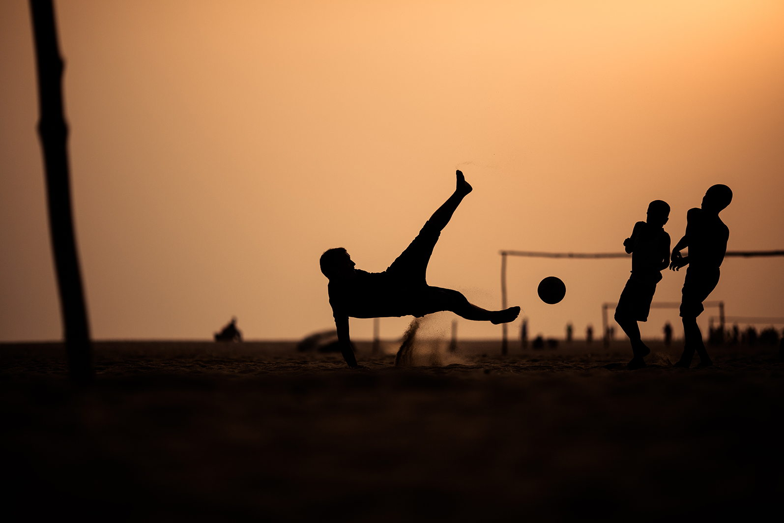 30 Action-Packed Photos Of People Playing Football/Soccer At Sunset