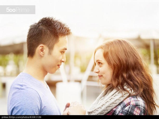 Young couple affectionately facing each other
