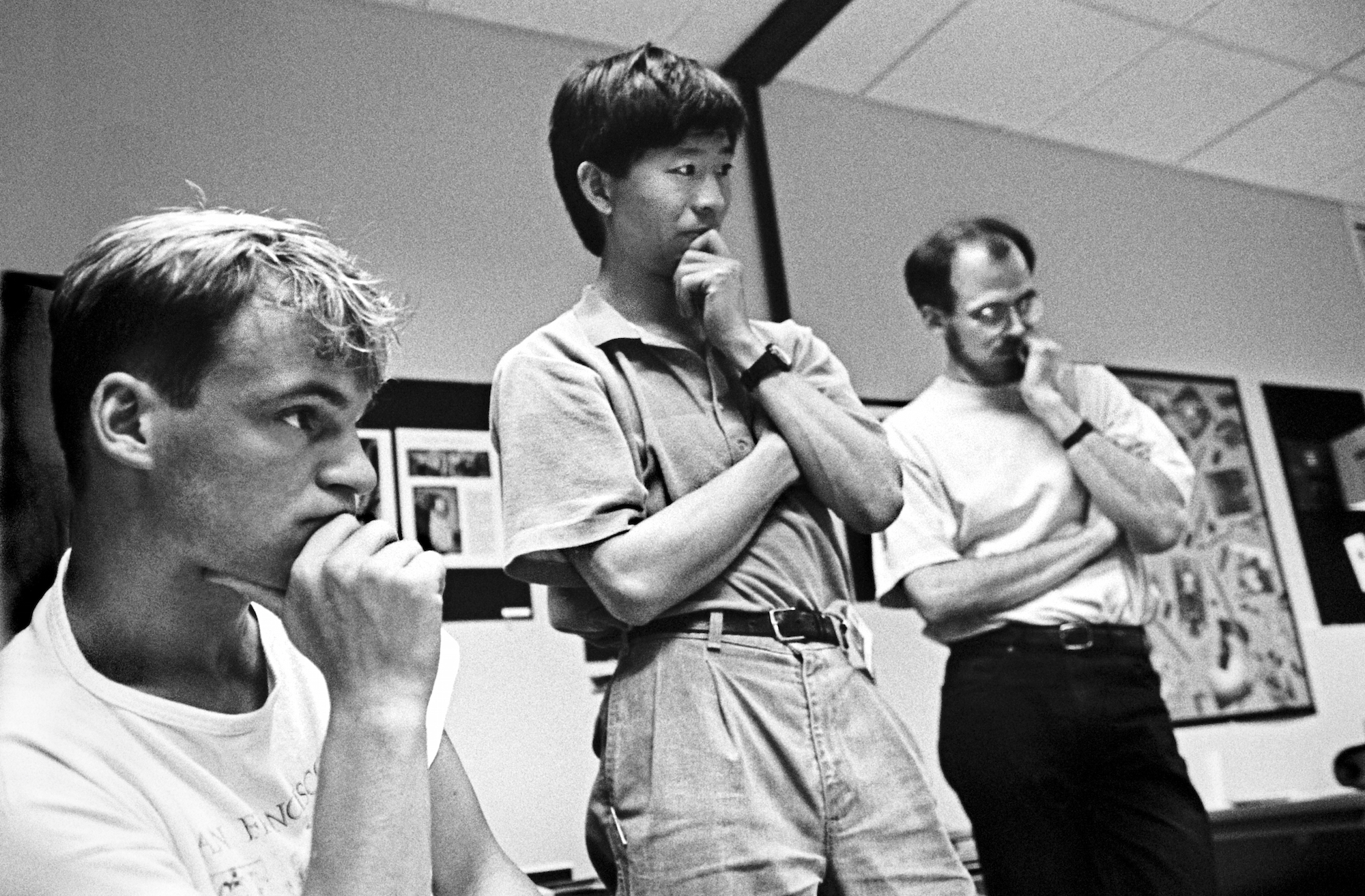At the 1990 Adobe Photoshop Invitational, members of Adobe's creative team (back row, from left)_ Min Wang and Russell Brown along with an unidentified artist, 1990