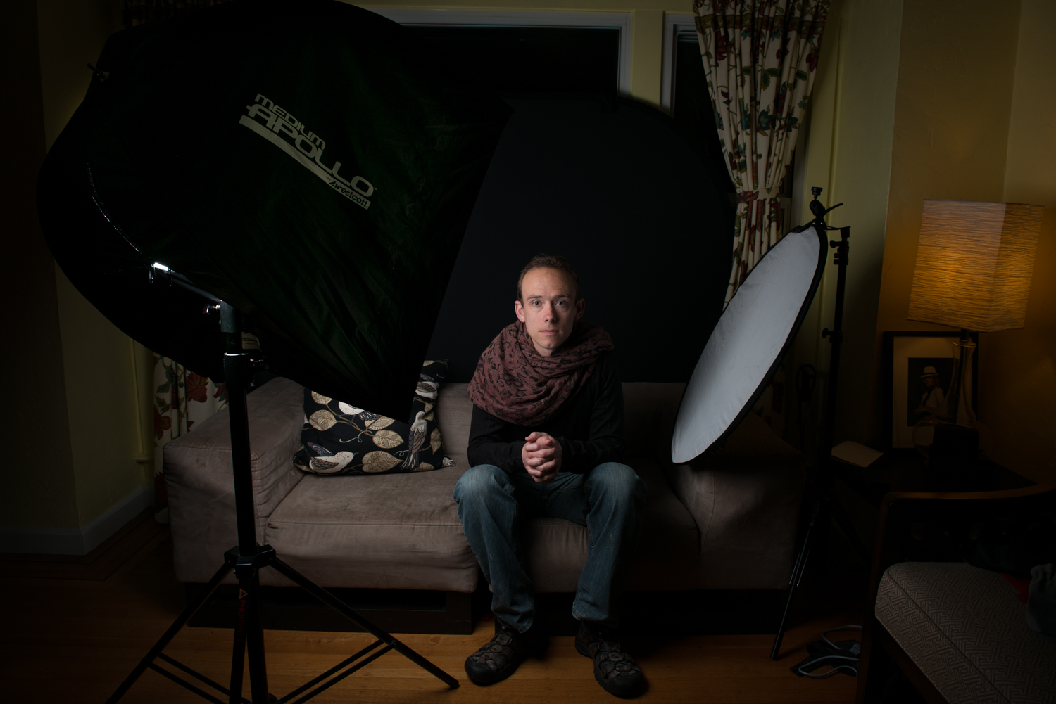 On location in my model, Brian's, home. Here I am using a small flash inside a Westcott Apollo softbox. This setup is very versatile and easy to carry around.