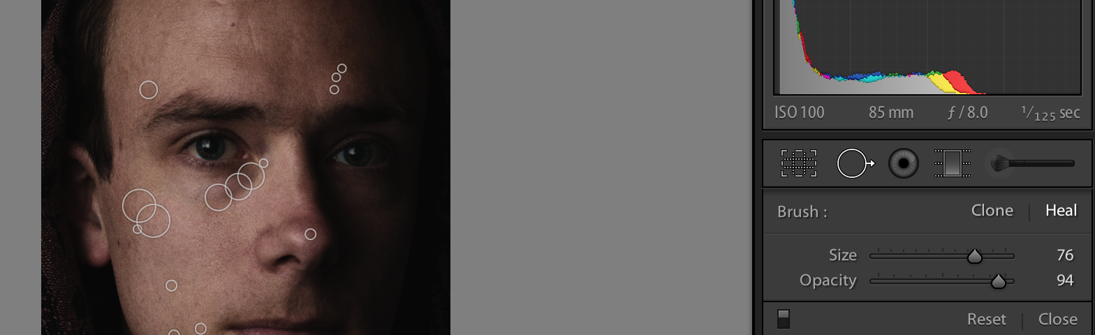 Using a lower-opacity healing brush, I make some spot adjustments in Lightroom.