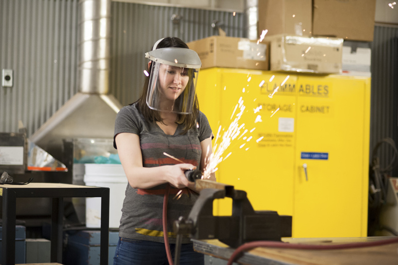 Woman welding.