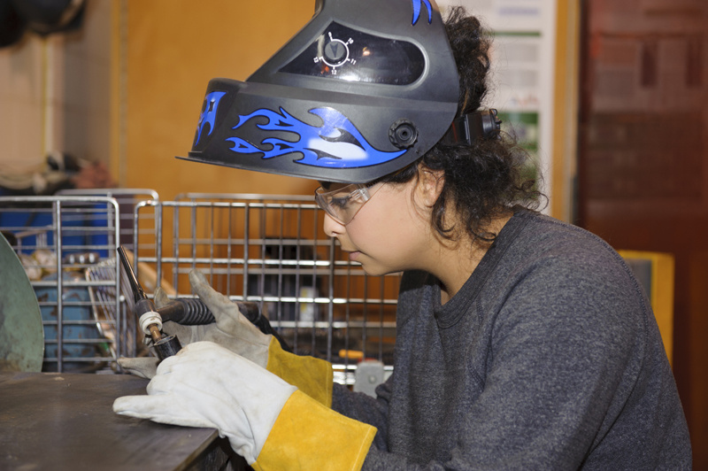 Woman preparing to weld.
