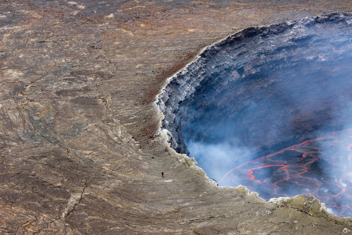 Incredible Photo of a Man On the Edge of the World's Largest Lava Lake