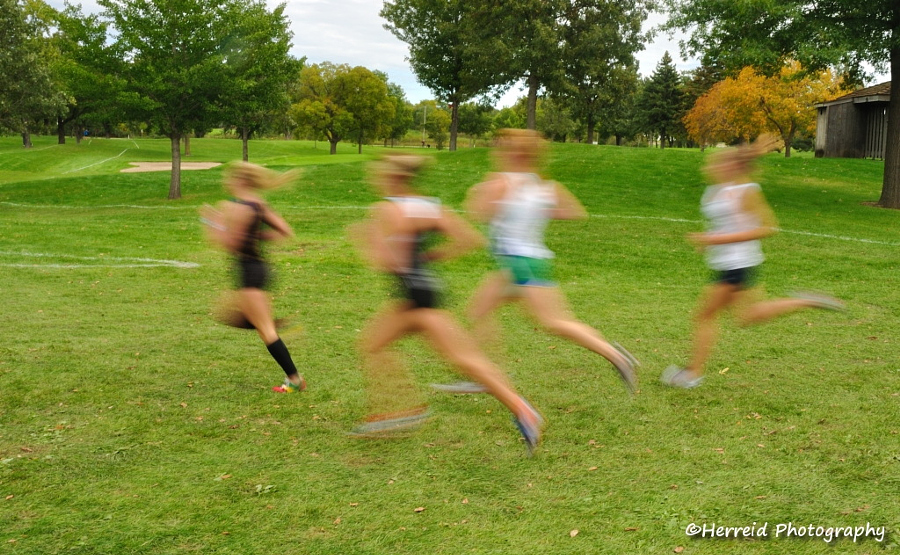 Blurred Girls Cross Country Runners