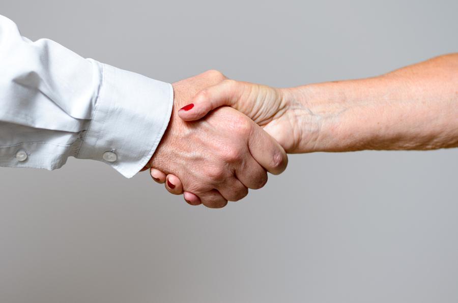 Conceptual Handshake Gesture of Two Adult Hands