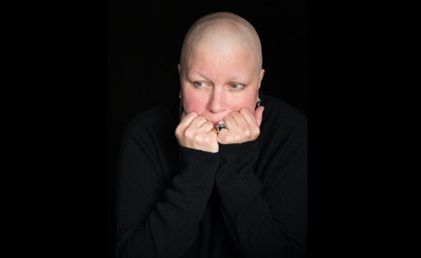 Female ovarian cancer patient looks on with fear and uncertainty; healthcare photographer; pharmaceutical; cancer; chemotherapy