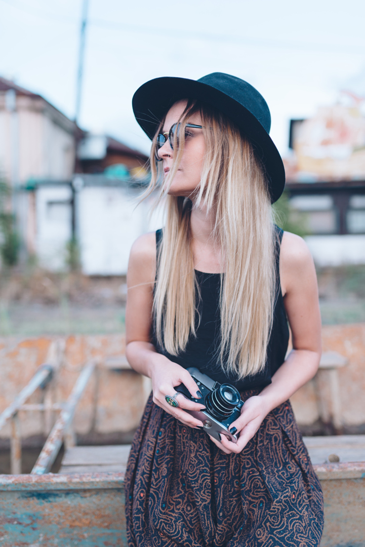 Girl with analog camera outdoors