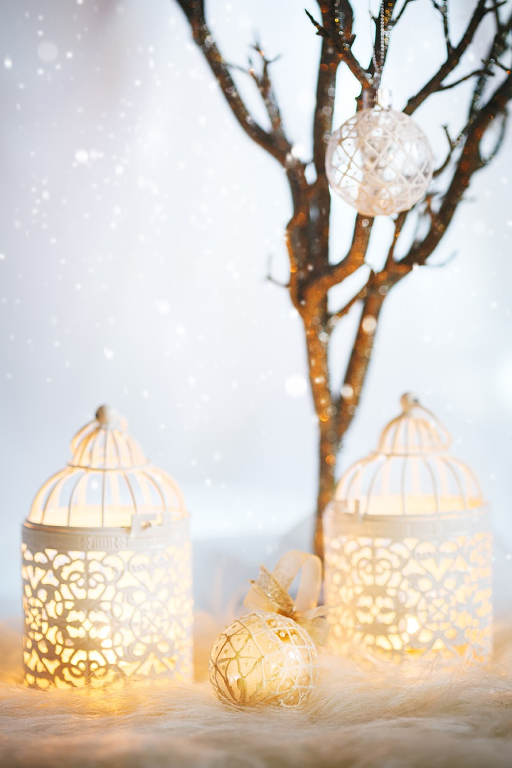 White Christmas card. Decoration with lanterns. Vintage, retro composition. Selective focus on white bauble.