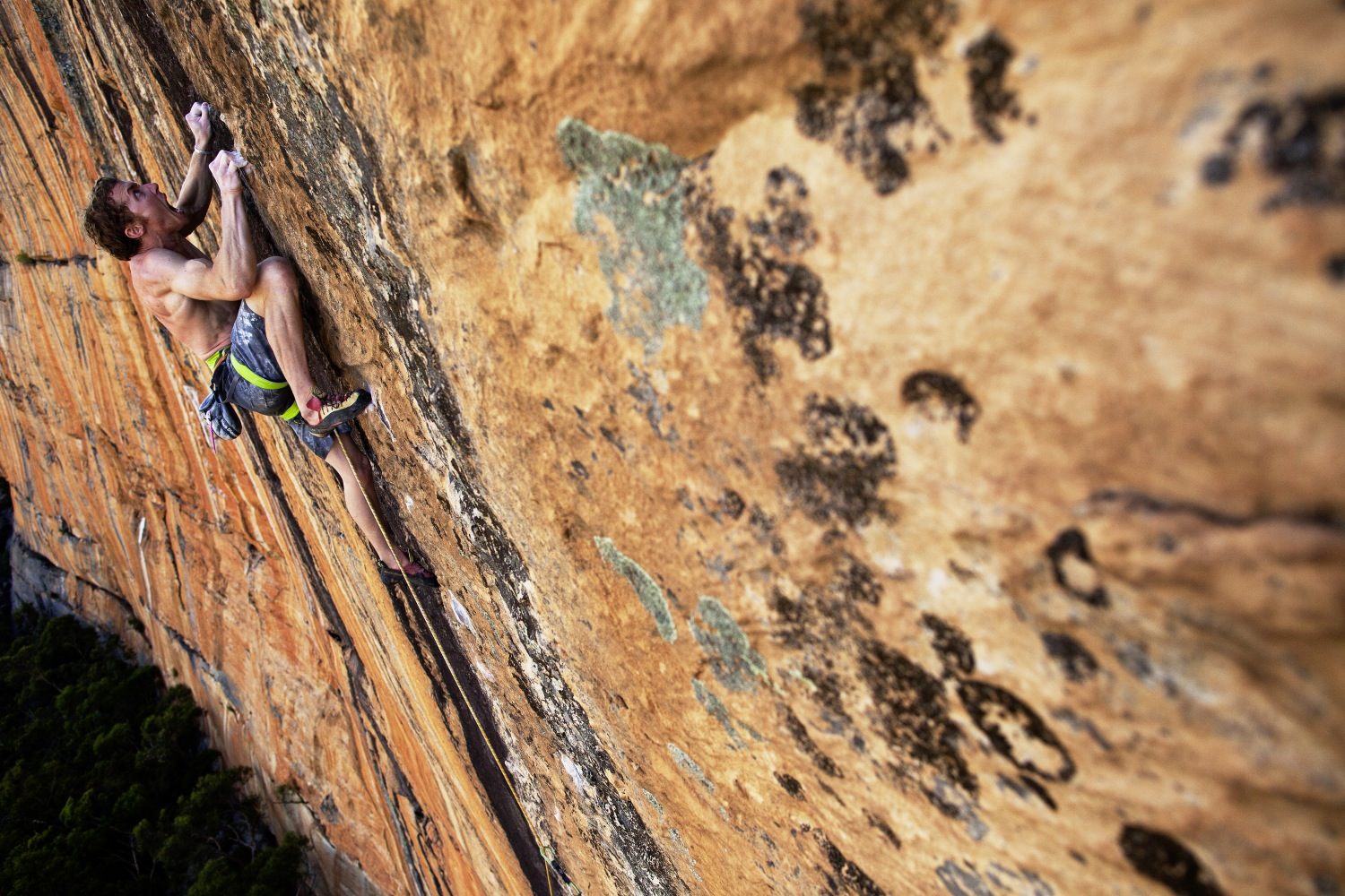 One of Australia's best climbers Ben Cossey, sends Groove Train 33/8c+ on Taipan Wall in the Grampians, Australia.