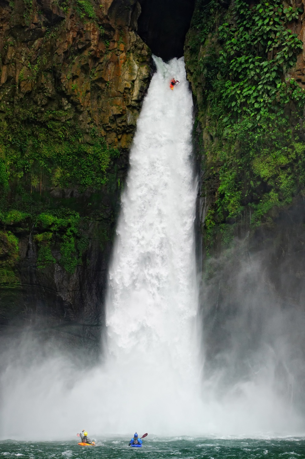 Red Bull Athlete Rafa Ortiz drops the 128.6 foot tall Big Banana Waterfall on the Rio Alseseca in the Sierra  Madre Mountains in Veracruz, Mexico. This was the first descent of the monster waterfall. Ortiz ran the waterfall cleanly and came away unhurt except a badly blackened eye and 3 stitches.  The waterfall is called Big Banana due to the numerous banana plantations in the region.  ©Lucas Gilman 2010 - All Rights Reserved p: +1 303-218-0707 e: lucas@lucasgilman.com