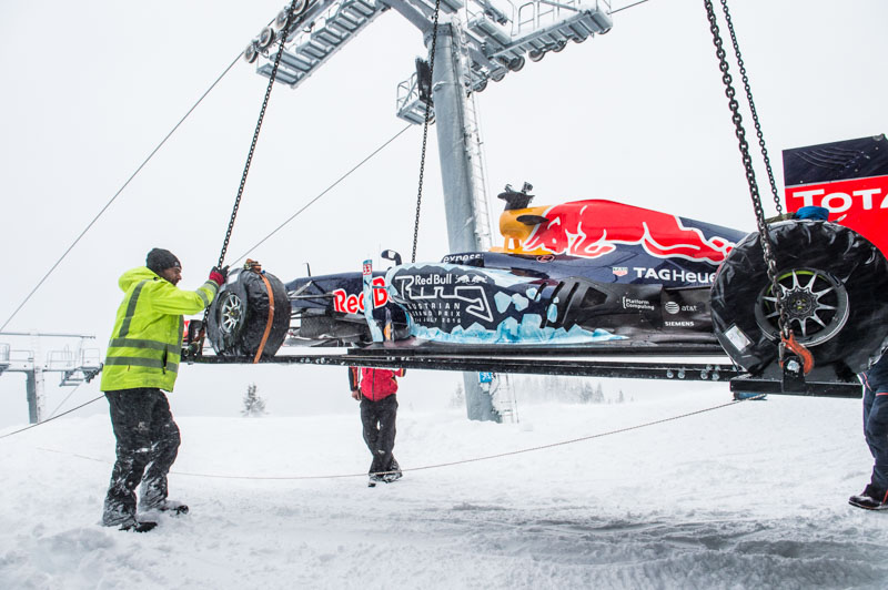 The F1 Race Car gets a lift to the start of the Showrun at the Hahnenkamm in Kitzbuehel, Austria on Jannuary 12, 2016.