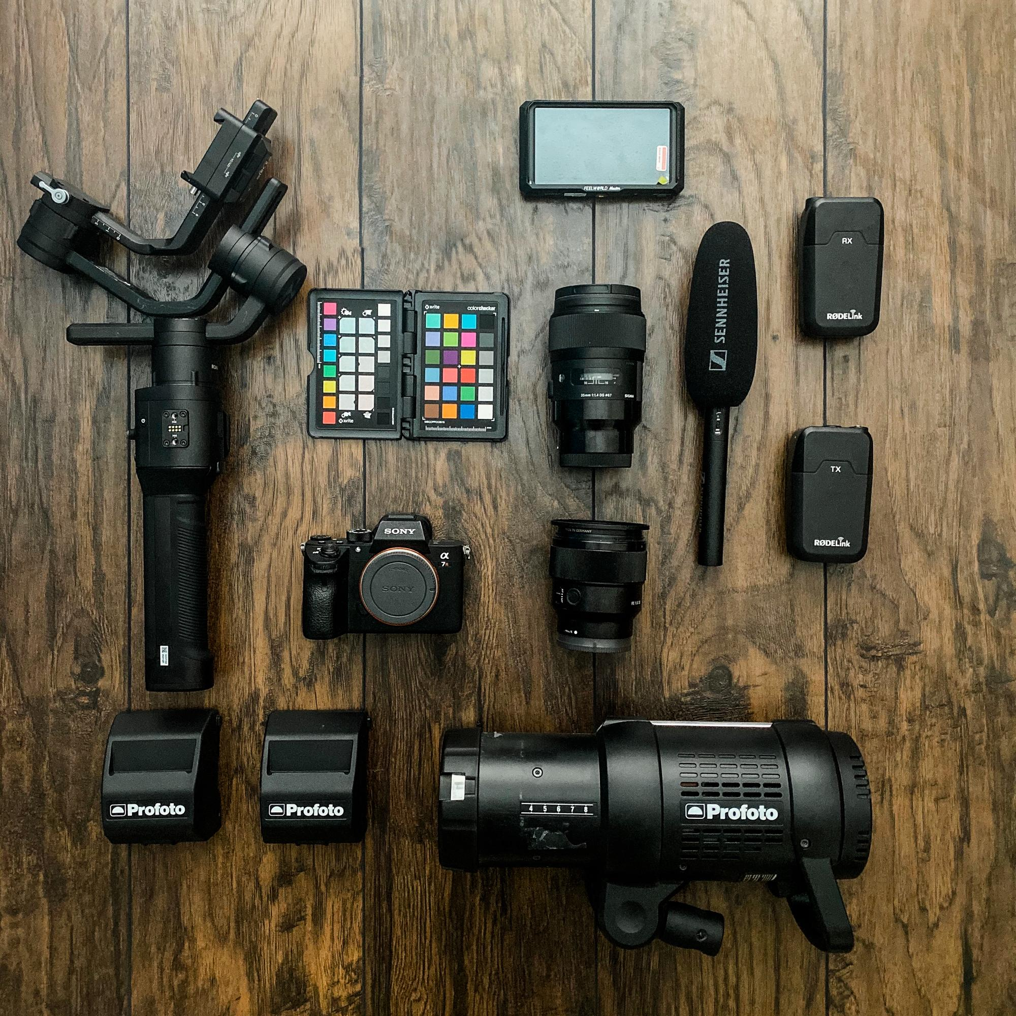 Camera equipment for a photographer laid out on a wood table